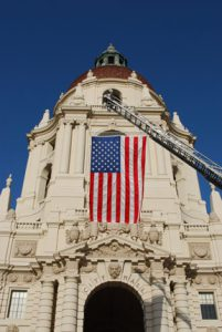 This is a picture of the U.S.A. Flag on special display in front of national historic landmark City Hall building at beautiful Pasadena, California