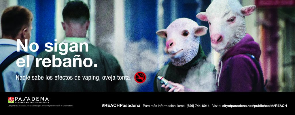 "Public Service Announcement in Spanish about the dangers of vaping and e-cigarettes, especially by young people who often pick up the addictive habit due to a ""herd mentality"" of peer pressure. Image shows young people as sheep vaping."