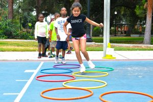 Image of girl jumping through hoops at Washington Camp