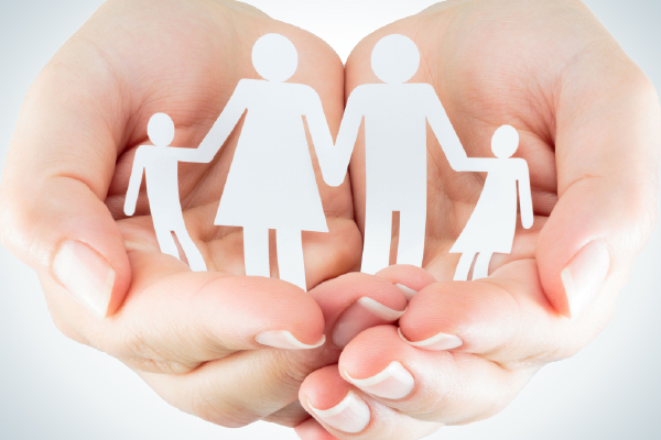 Image of Hands with paper family cutout