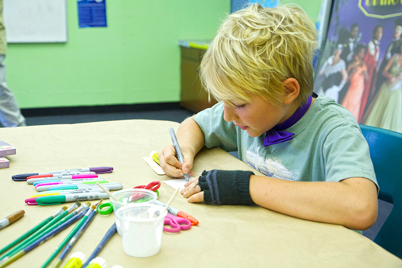 Image of kid drawing at Allendale Camp