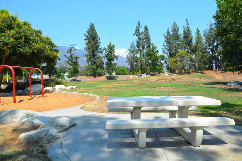Image a picnic table and swing set at Eaton Sunnyslope Park