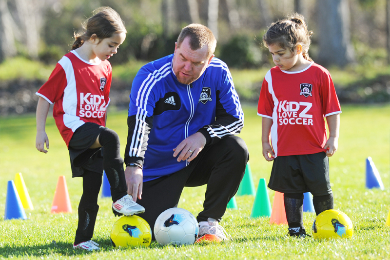 Image of Instructor and Kids ar the Fun In The Sun Soccer Mini-Camp