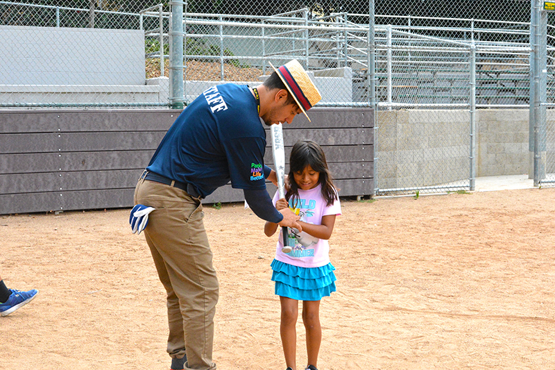 Image of Instructor and kid at Sports Camp