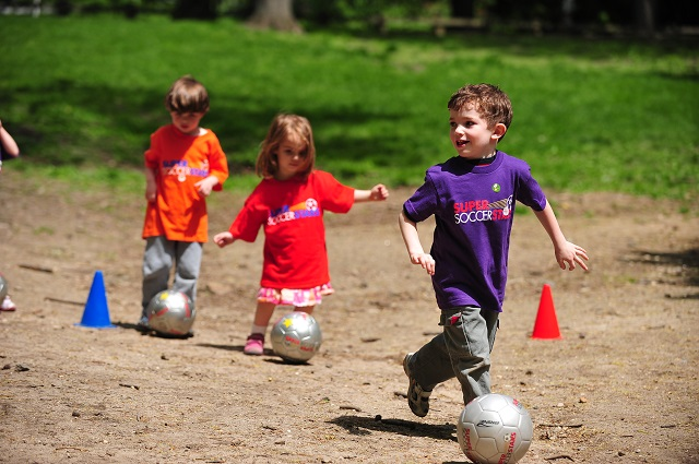 Image of kids playing with soccer ball at the Super Soccer Stars Kick it Camp