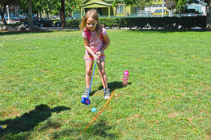 Image of girl playing golf at Urban Adventure Camp