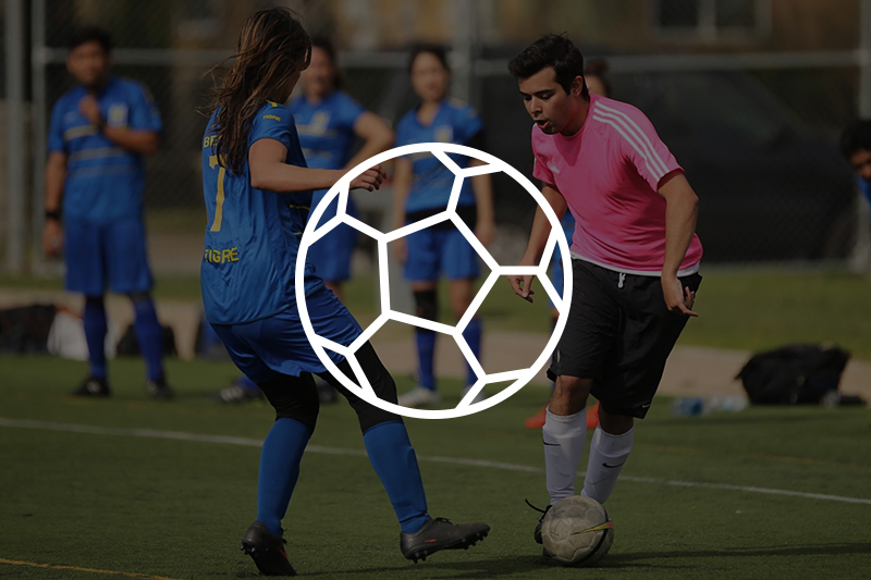 Image of adults playing soccer