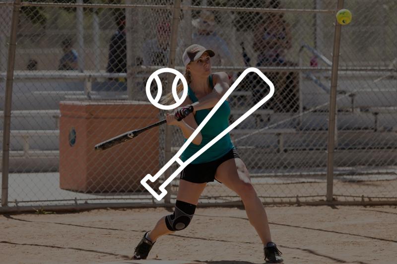 Image of woman swinging a baseball bat