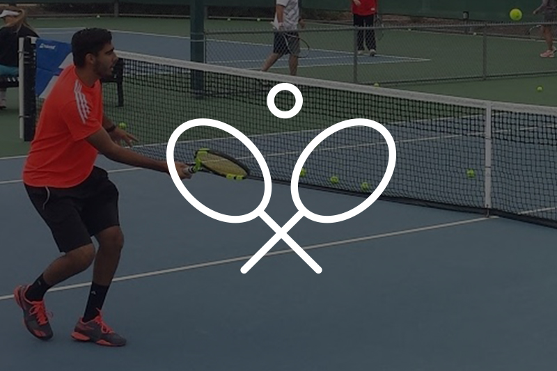 Image of an adult playing tennis