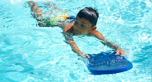 Child Using Floatation Board image