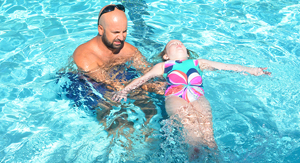 Instructor Teaching Child to Float image