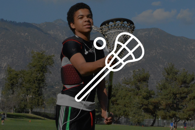 Image of lacrosse icon with kid playing in the background