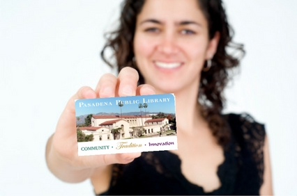 Woman holding library card