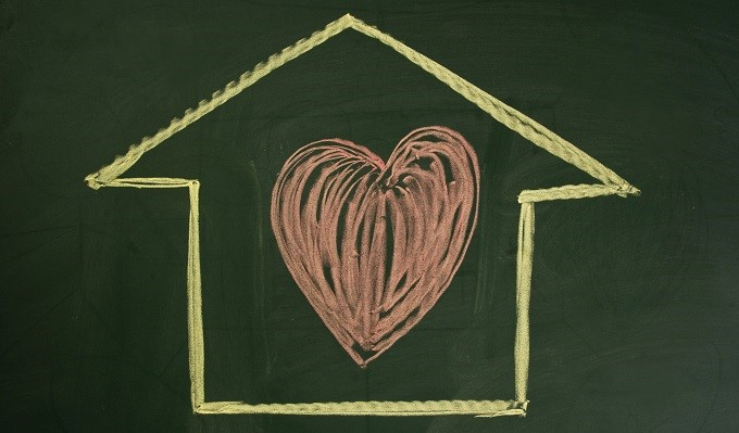 Chalkboard with drawing of house and heart