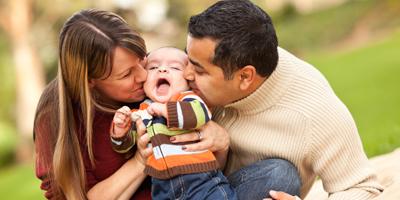 parents kissing child