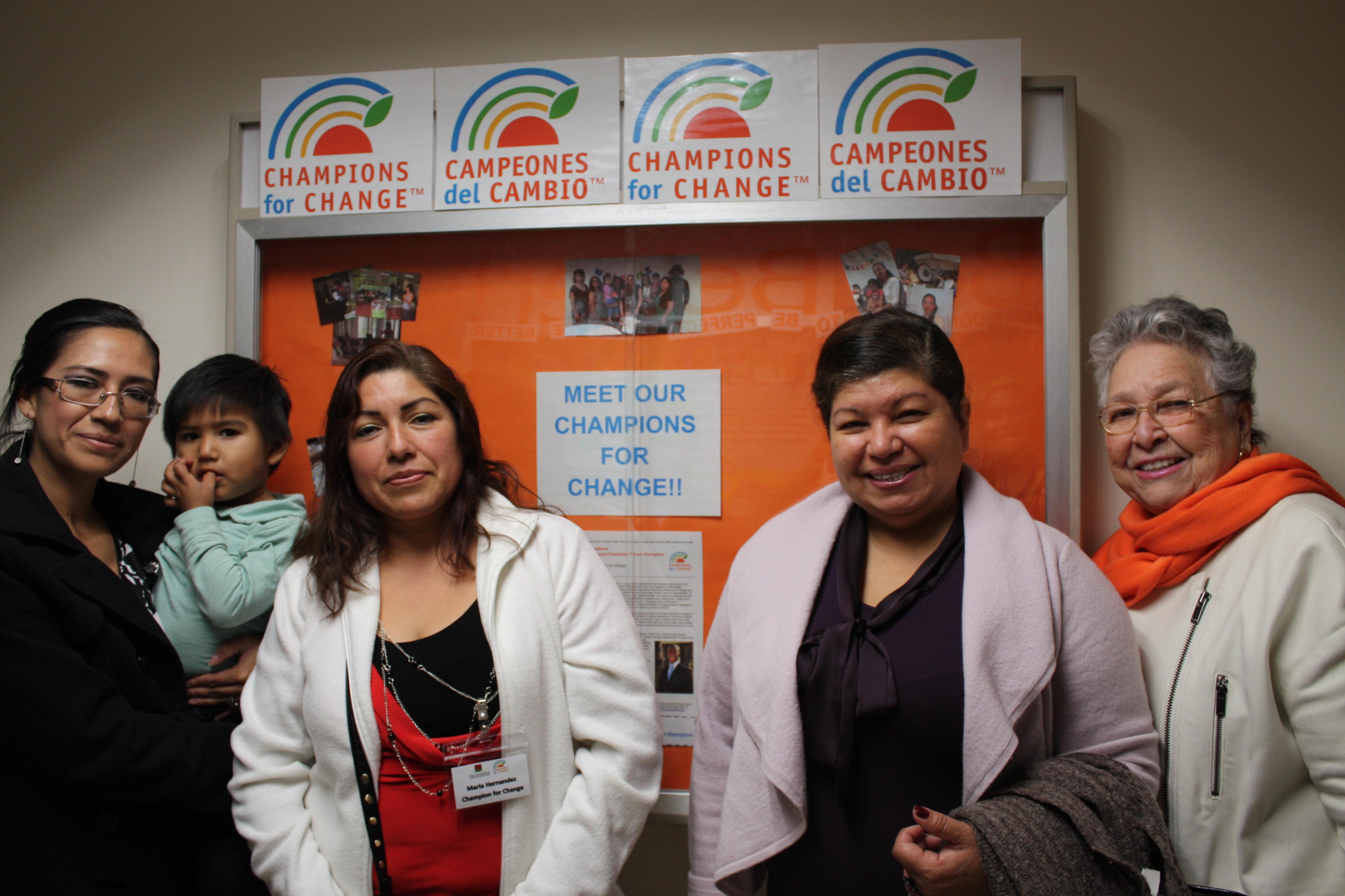 Women posing infront of bulletin board