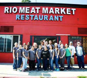 Group posed in front of Rio Meat Market