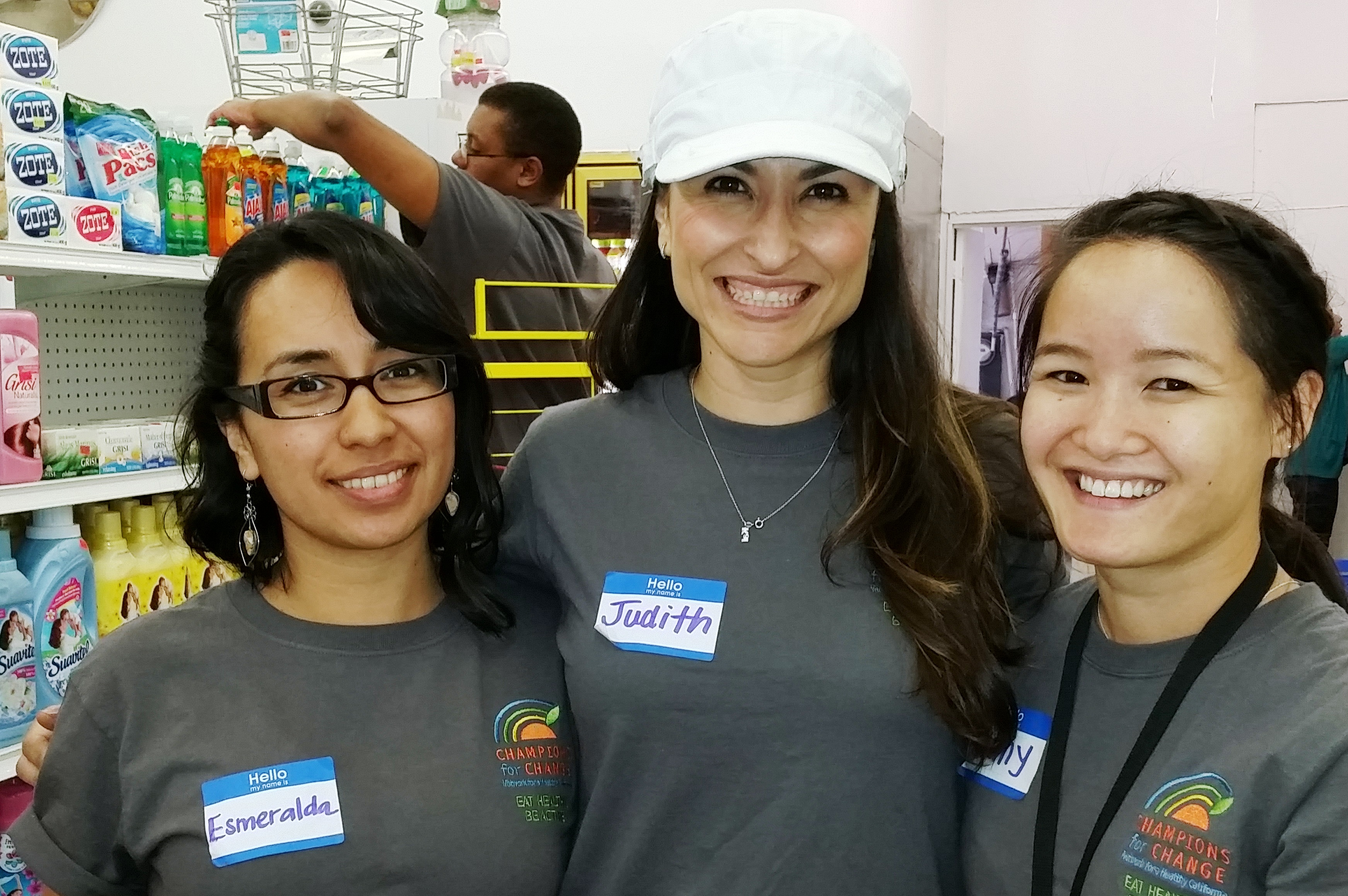 Three women posting in store aisle