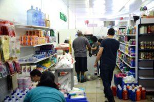 Volunteers at in store aisle