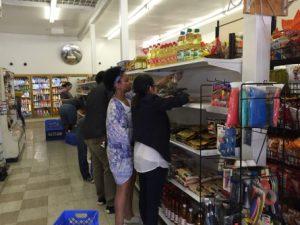 Volunteers organizing shelf