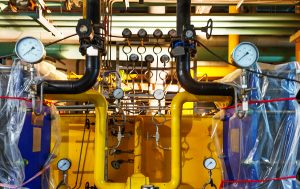 Modern boiler room equipment for heating system. Pipelines, water pump, valves, manometers.