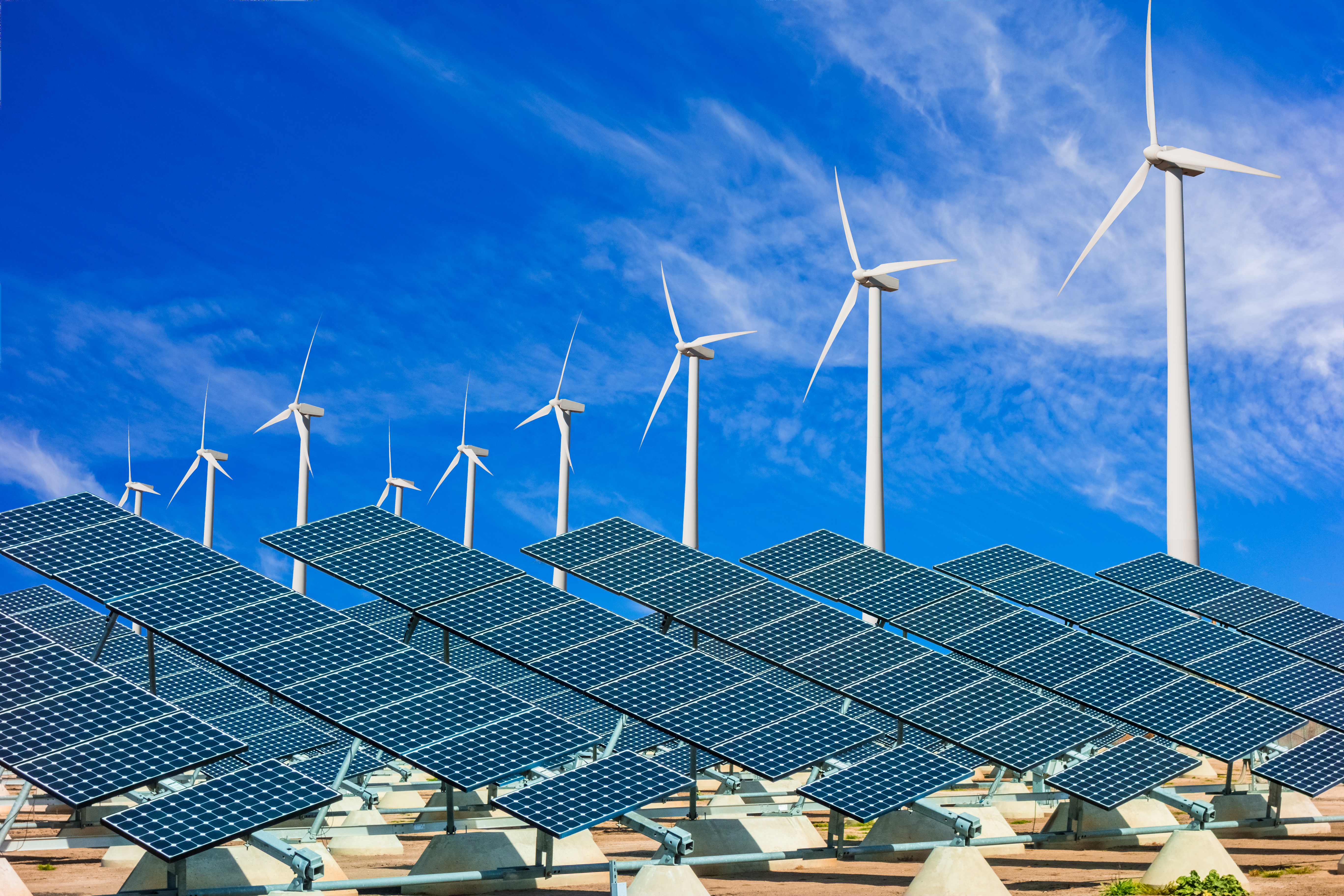 Wind turbines and solar panels making green energy