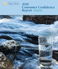 image of a glass of water and water river hind it for consumer confidence report