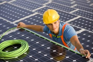 Image of an electrician at a photovoltaic farm