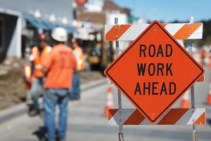 Road work, shallow DOF, focus on the sign