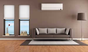 Contemporary brown living room with two windows. Heat pump above couch