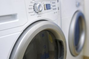 Close up view of a modern, front loading, clothes washer and dryer.