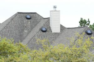 Solar powered attic vents on houseS
